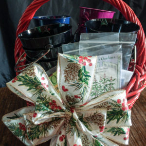The supplies needed to make an herb garden advent calendar in a gift basket.