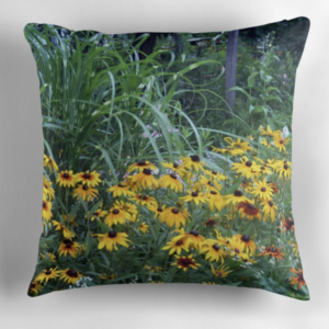 Ornamental grass and black eyed Susans in a landscape on a pillow.